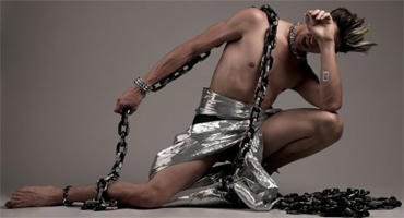 person wrapped in chains and suran wrap