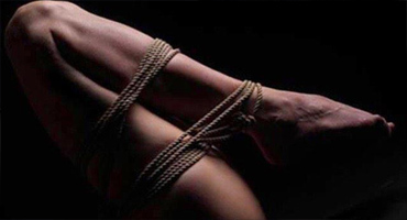 Woman's legs bound by rope in safe, sane, & consensual philosophy