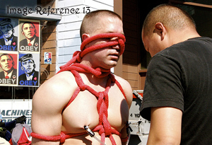 Man tied up in rope with nipple clamps on