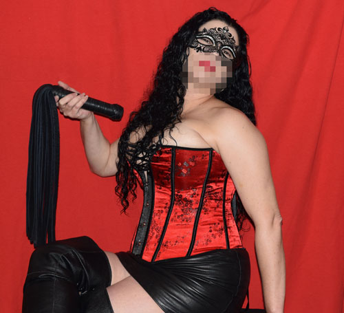 Lady Quill with flogger